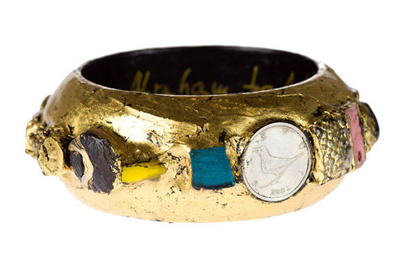 Bangle 111: brass amulet from Vietnam, silver coin with bird image, mother of pearl button, old china, shell, Venetian glass, Chinese facsimile coin, semi precious stones, Venetian glass